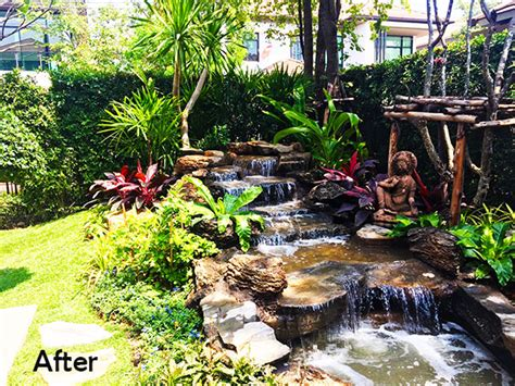 Tropical Rock Waterfall, Pond And Shaded Deck In Bangkok