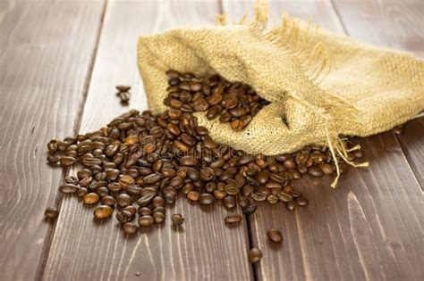 Bada bean sweetest coffee beans. Dark Brown Coffee Beans Sweet Arabica On Brown Wood Stock Photo - Image of arabian, bright ...