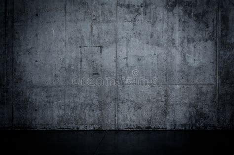 grungy dark concrete wall  wet floor stock image