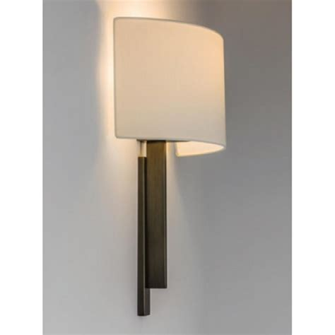 hotel style wall light in bronze with curved white fabric