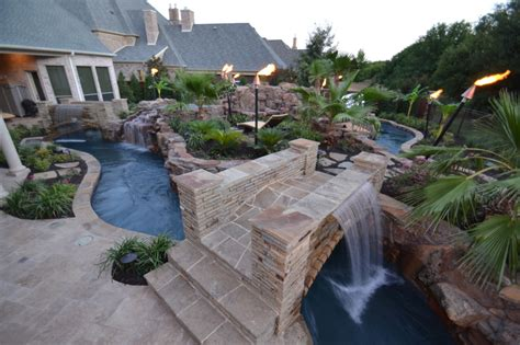 Large Backyard Lazy River Pool Design With Rock And Garden