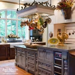 kitchen island with pot rack kitchen mediterranean kitchen richmond by cabell design studio