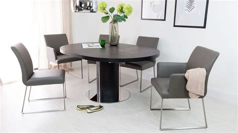black round dining table and chairs black ash round extending dining table pedestal base uk
