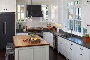 white wooden kitchen cabinet with black counter top having With kitchen cabinet trends 2018 combined with bronze tree wall art
