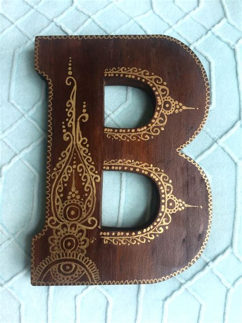 decorated wooden letter dark stain gold paint wooden