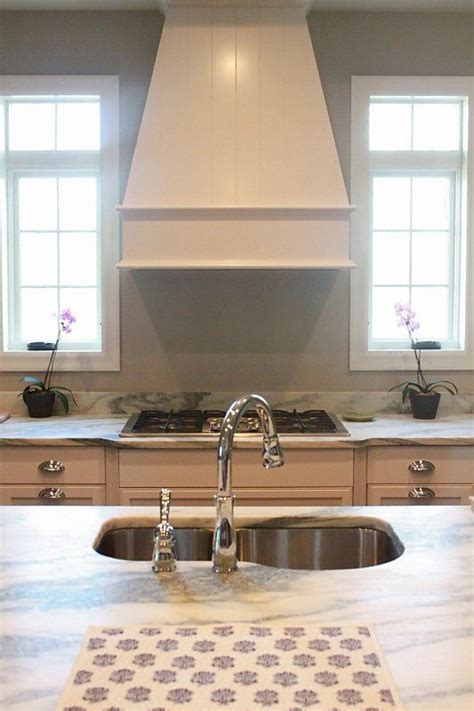 kitchen  white marble stained island cream cabinets