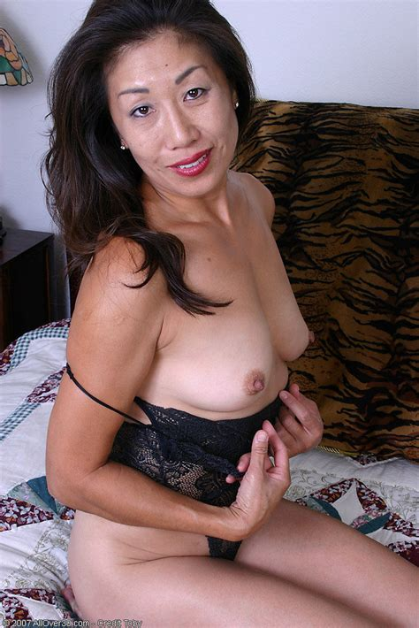 Exotic mom in black lingerie peels and spreads her asian pussy