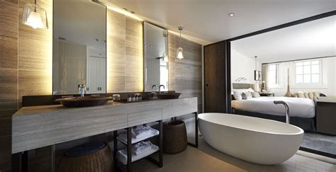 Hotel Bathroom Design by A Hospitality Bathroom Design With A Sliding Door That