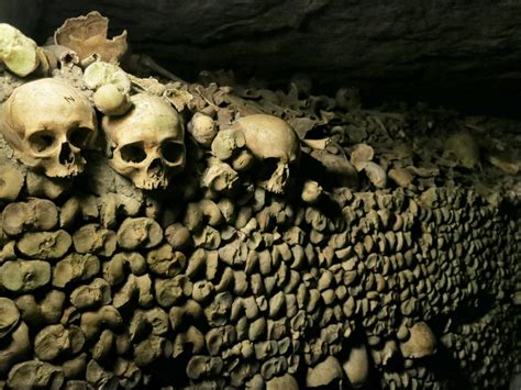wall  bones catacombs paris france mikestravelguidecom