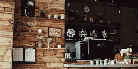 Smiling young woman is sit in a cafe. Best Coffee Shop Music Playlists | SoundMachine