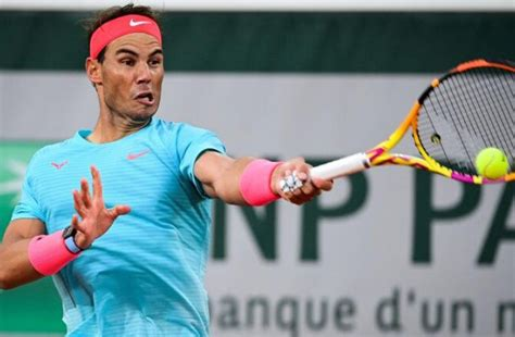 Record-chasing Nadal eases into French Open second round
