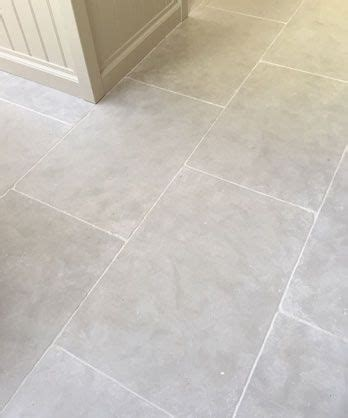 gray tile floor kitchen grey tumbled limestone kitchen floor tiles light 3937