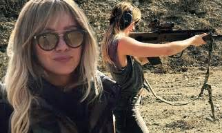 hilary duff posts instagram picture   firing rifle