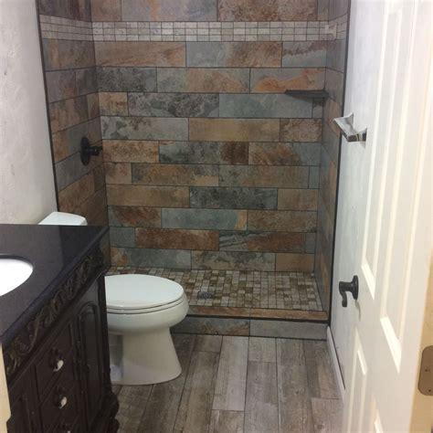 installed slate tiles  mosaic shower base