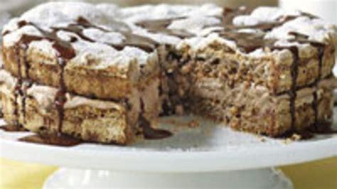 hazelnut meringue cake  chocolate sauce recipe sbs food