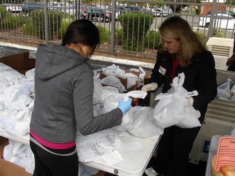 Eli Lilly Volunteers With Sacramento Food Bank & Family
