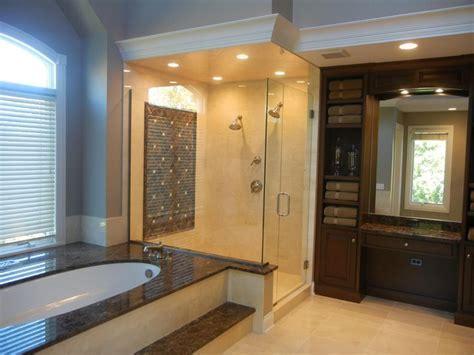 Crema Marfil & Dark Emperador marble bathroom.   Bathroom