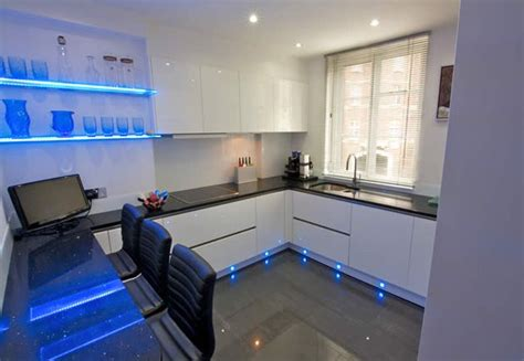 kitchen plinth lighting ideas a contemporary handleless white gloss kitchen is energised 5533