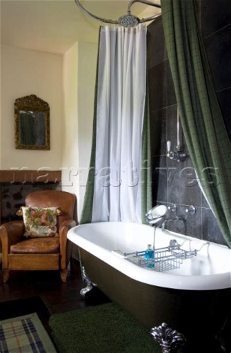 freestanding bath with green shower curtain in scottish