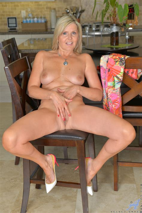 Beautiful Milf Strips Naked And Finger Fucks Her Pussy At