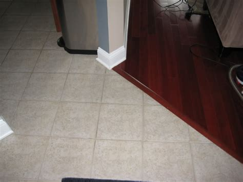 laminate wood flooring next to tile laminate flooring against tile larger selections of laminate tile flooring itsbodega com