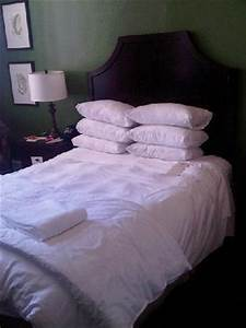 comfy bed with lots of pillows fluffy duvet and crisp With bed with lots of pillows