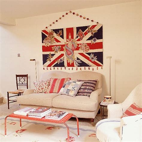 Living Room With Union Jack Wallhanging, Sofa And Coffee