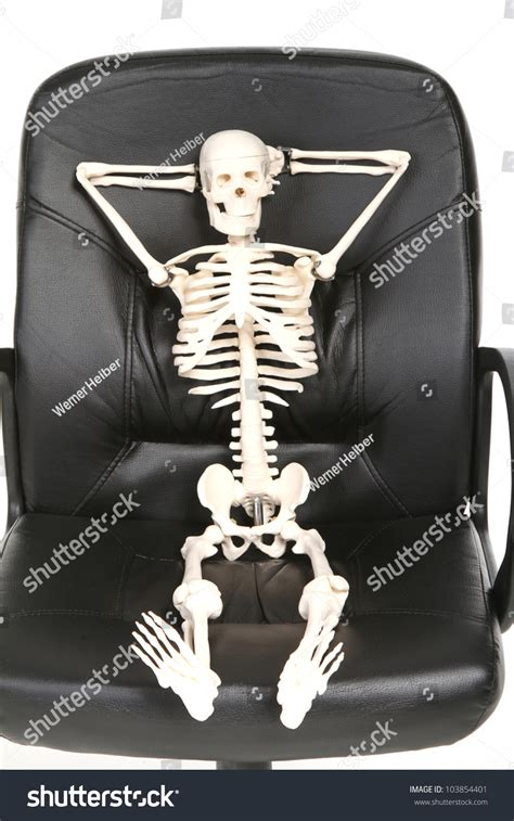 skeleton in an office chair stock photo 103854401