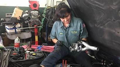 Mechanics Female Under Hood