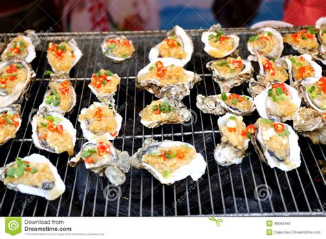 delicious cuisine grilled oyster seafood cuisine food stock photo