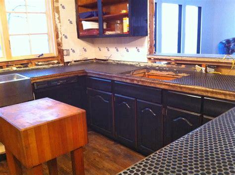 river house renovation penny tile slate kitchen counter