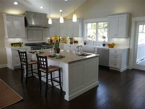 white kitchen cabinets floors room with wood flooring camer design 1796
