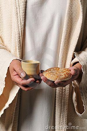 jesus holding  bread   wine royalty  stock photo