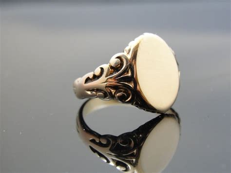 instead of a wedding band maybe a signet ring with his