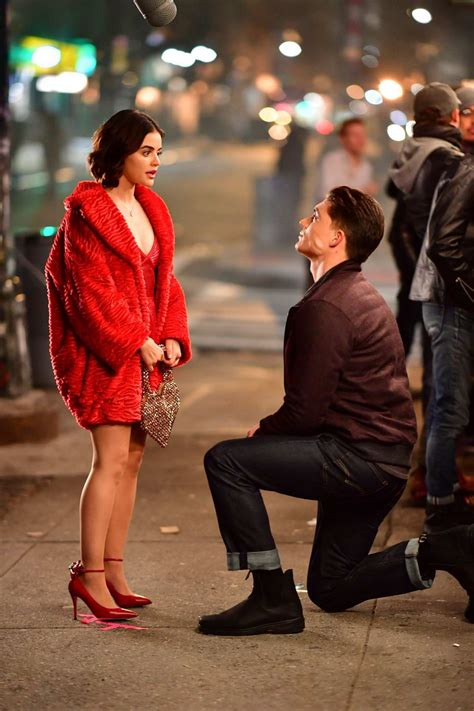 lucy hale looks pretty in red while filming scenes on set ...