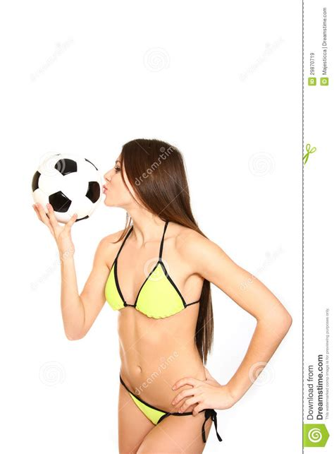 young woman   swimsuit holding  kissing  soccer