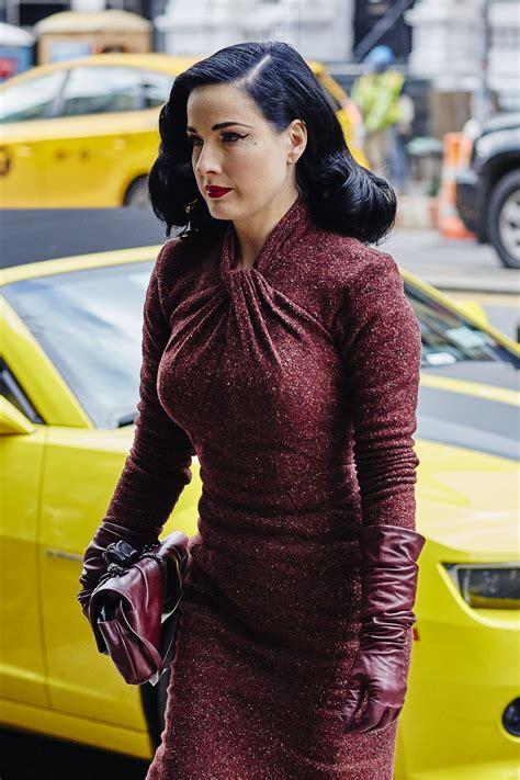 dita von teese  red retro tweed dress arriving   hotel   york  celebmafia