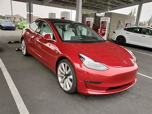 interior: Red Tesla Model 3 White Interior