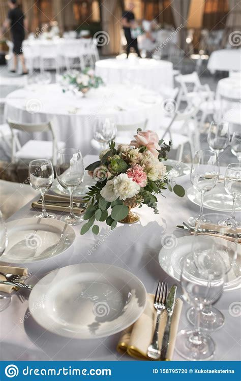 Wedding Table Setting Decorated With Fresh Flowers In A
