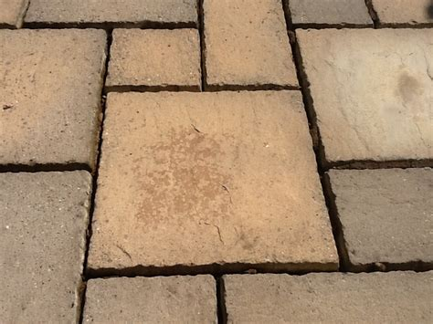 stained and damaged sandstone patio restoration in rushden