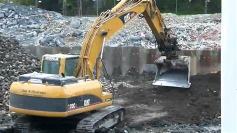 cat cl excavator digging moving dirt youtube