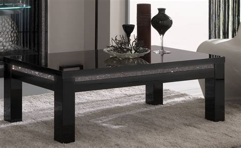 A bold bronze finish makes this tripod legged set a luxurious choice for any room. 15 Ideas of Modern Black Glass Coffee Table