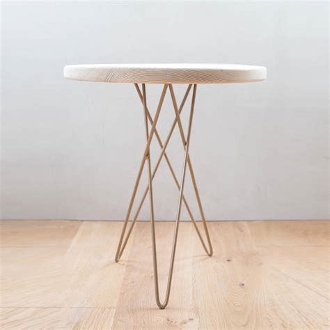 hand  wooden side table  gold hairpin tri leg
