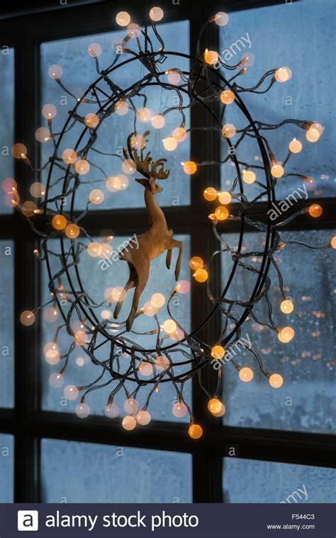 how to hang christmas lights inside windows christmas lights hanging on window indoors iceland stock