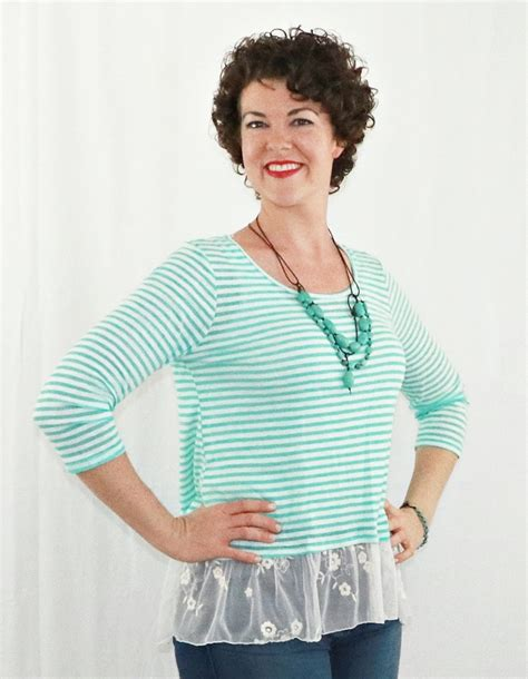 mint green striped top with sheer lace lace back button