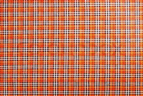 Plaid fabric red, orange, black, white, background   Stock