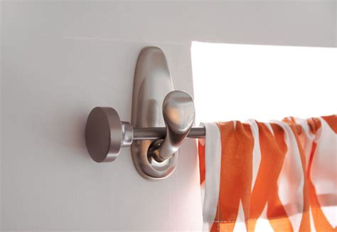 hang a curtain rod on command hooks living room
