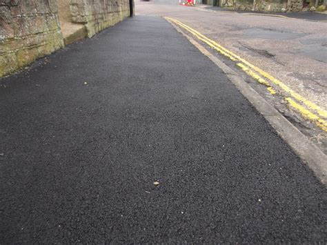 picture of pavement quality of pavement resurfacing not up to scratch forcing re resurfacing