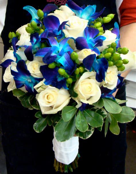 blue flowers wedding bouquet  blue orchids  white