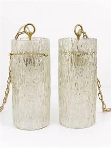 Two matching pair of kalmar glass tube brass pendant lamps